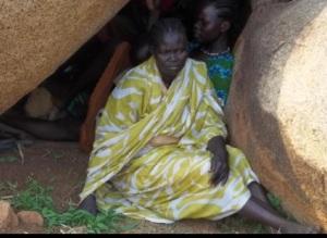 Women hide from bombers