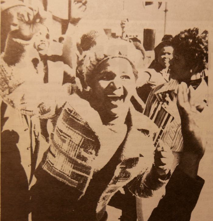 Black woman with fist salute
