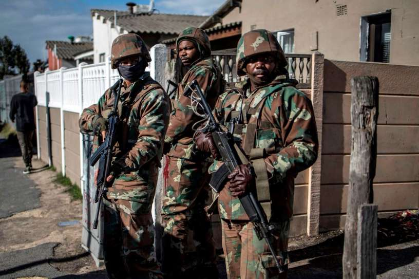 SANDF soldiers secure the perimeter of a police operation during a joint patrol with the South African police in the Cape Flats area in Cape Town, on August 8, 2019.