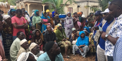 Displaced people gather for a food distribution in Mocímboa da Praia, Cabo Delgado, where a once shadowy insurgent group is seeking to broaden its appeal among local residents