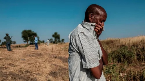 A man looks at bodies in a ditch in Mai-Kadra, Ethiopia. There have been all-too-credible accounts of civilian massacres on all sides